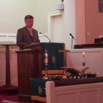 Hayden Collins speaking at the First United Methodist Church